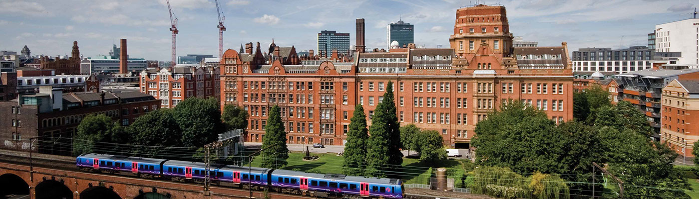A train passing in front of the Sackville Street Building