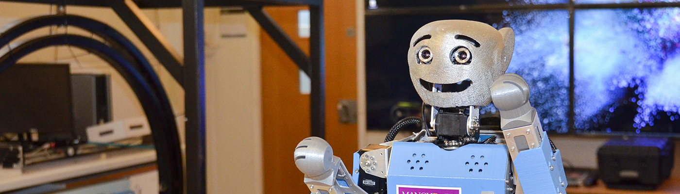 A smiling robot in the Robotics Laboratory