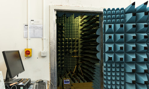 An open door showing the interior of the anechoic chamber