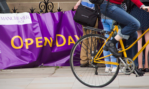 A bicycle in front of an open days banner