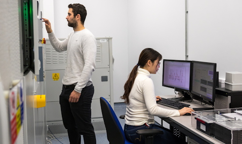 Female and male researcher in lab