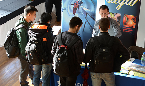 Students asking questions at a careers fair
